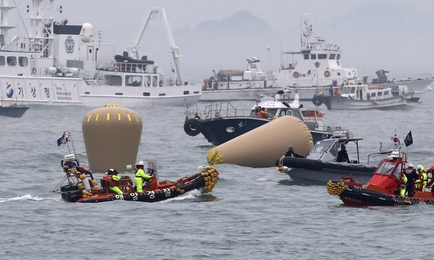 south-korean-navy-officials-work-on-buoys-to-mark-the-sunken-passenger-ferry-the-sewol-in-the-water-off-the-southern-coast-near-jindo-south-korea-on-friday-april-18-2014