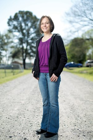Dawn Louden, 40, stands on Lancaster Lane, the road she lives on in Conway, near the site where a yard sale and concert will be held May 3 to help pay for her stem-cell transplant. After doing extensive research, she plans to have the transplant, using her own stem cells, in either Chicago or Russia.