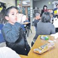 STAFF PHOTO FLIP PUTTHOFF CLASSROOM BREAKFAST Jimmy Azanza sips chocolate milk Friday that was part ...