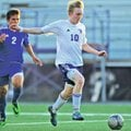 STAFF PHOTO ANDY SHUPE Nicholas Kley of Fayetteville moves to score past Rogers High's Alex Va...