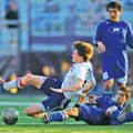 STAFF PHOTO ANDY SHUPE Wilson Valdez, right, of Rogers High fouls Fayetteville's Mitchell Dutt...