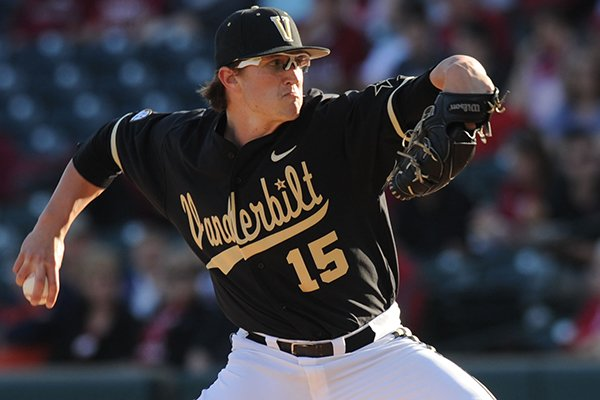 Vanderbilt starter Carson Fulmer delivers a pitch during the first inning against Arkansas Saturday, April 19, 2014, at Baum Stadium in Fayetteville.