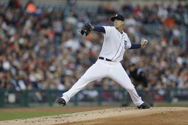 Detroit Tigers starting pitcher Drew Smyly throws during the second inning of a baseball game against the Los Angeles Angels in Detroit, Friday, April 18, 2014. (AP Photo/Carlos Osorio)