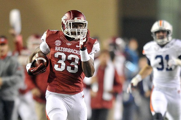 Arkansas running back Korliss Marshall returns a kick 86 yards during the third quarter of a game against Auburn on Saturday, Nov. 2, 2013 at Razorback Stadium in Fayetteville.