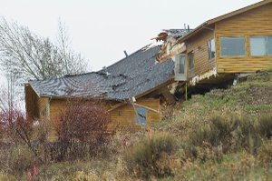 Looming, creeping landslide splits home in Wyoming