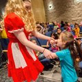 Rogers High senior Lori Kyles dances in the audience with Mathias Elementary kindergartener Serenity...