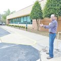 STAFF PHOTO ANTHONY REYES Brian Barr with HealthSouth Rehab Hospital shows April 11 where a new addi...