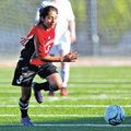 STAFF PHOTO JASON IVESTER Springdale's Blanca Barroso chases down a ball against Rogers Herit...