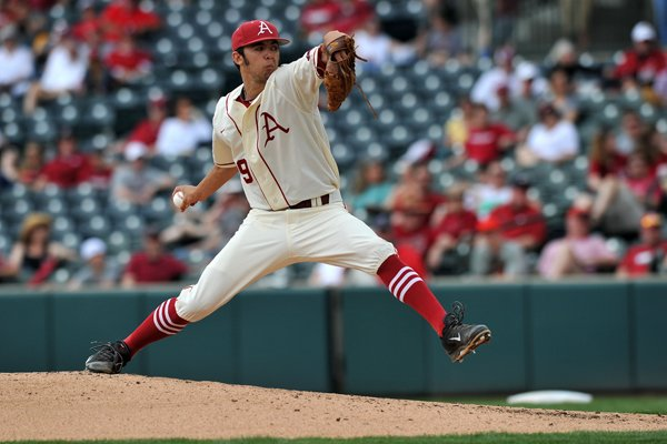 Arkansas pitcher Chris Oliver fires a pitch in the 2nd inning of the Razorbacks' game against Vanderbilt Sunday, April 20, 2014, at Baum Stadium.