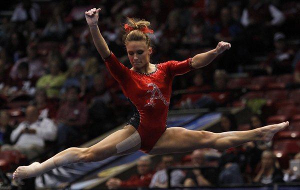 Arkansas' Katherine Grable competes on the floor exercise during the NCAA women's gymnastics championships on Friday, April 18, 2014, in Birmingham, Ala. (AP Photo/Butch Dill)