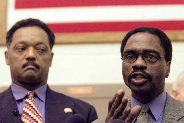 in-this-march-3-2000-file-photo-the-rev-jesse-jackson-left-listens-as-rubin-hurricane-carter-the-former-middleweight-boxer-speaks-during-a-news-conference-inside-the-north-county-correctional-facility-in-castaic-calif-carter-who-spent-almost-20-years-in-jail-after-twice-being-convicted-of-a-triple-murder-he-denied-committing-died-at-his-home-in-toronto-sunday-april-20-2014-according-to-long-time-friend-and-co-accused-john-artis-he-was-76