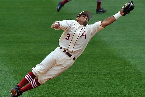 Arkansas shortstop Michael Bernal leaps to make an out on a hard hit line drive in the fifth inning of a game Sunday, April 20, 2014 against Vanderbilt at Baum Stadium in Fayetteville.