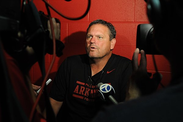 Arkansas associate head coach Sam Pittman during media day Sunday, Aug. 11, 2013 at the Fred W. Smith Football Center in Fayetteville.