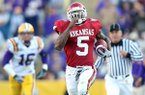 Arkansas running back Darren McFadden breaks a tackle by LSU safety Craig Steltz (L) to score touchdown in third quarter at Tiger Stadium in Baton Rouge, La. on Friday, Nov. 23, 2007.