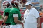 Arkansas offensive coordinator Jim Chaney, right, watches prior to a scrimmage Aug. 10, 2013 at Razorback Stadium in Fayetteville.