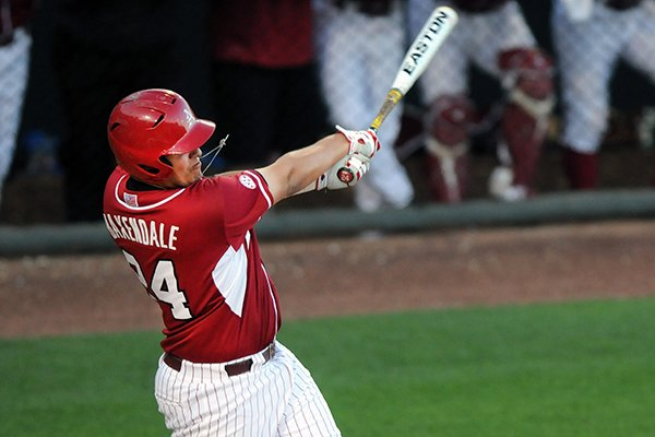 Arkansas' Blake Baxendale gets a piece of the ball Tuesday, April 22, 2014, during the game against Northwest State at Baum Stadium in Fayetteville.