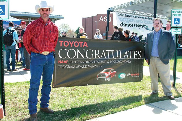 chuck-wisdom-left-and-jerry-sites-assistant-professors-of-agriculture-at-arkansas-state-university-beebe-were-presented-with-the-keys-to-a-2014-toyota-tundra-on-april-16-asu-beebe-received-a-two-year-lease-on-the-2014-toyota-tundra-after-being-recognized-as-one-of-the-top-six-outstanding-postsecondaryadult-agricultural-education-programs-in-the-us-by-the-national-association-of-agricultural-educators