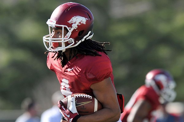 Arkansas receiver Keon Hatcher runs drills during practice Thursday, March 20, 2014 in Fayetteville.