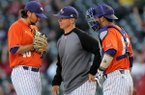 Chris Curry, center, Northwestern State pitching coach, has a chat with starting pitcher Brandon Smith, left, and catcher C.J. Webster Tuesday, April 22, 2014, during the game against Arkansas at Baum Stadium in Fayetteville.