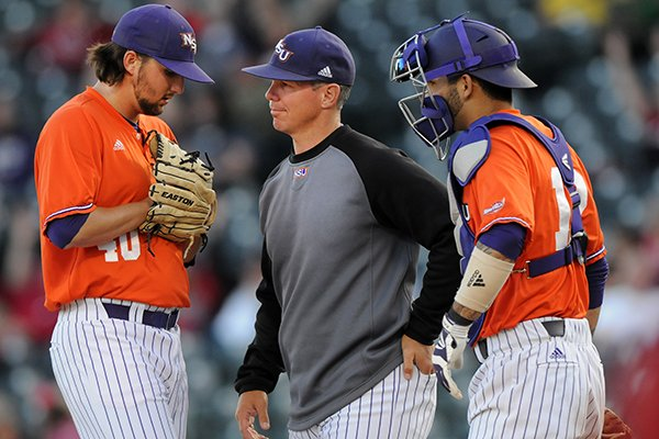 chris-curry-center-northwestern-state-pitching-coach-has-a-chat-with-starting-pitcher-brandon-smith-left-and-catcher-cj-webster-tuesday-april-22-2014-during-the-game-against-arkansas-at-baum-stadium-in-fayetteville