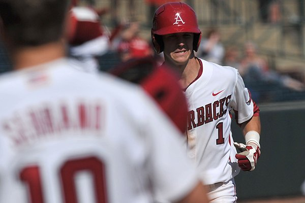 Arkansas batter Brian Anderson rounds the bases after a home run in the fourth inning of Wednesday afternoon's game at Baum Stadium in Fayetteville.