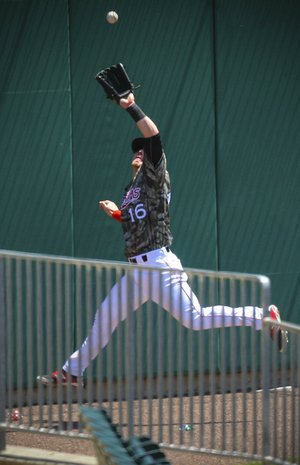 Arkansas Travelers left fielder Zach Borenstein leaps to catch a ninth-inning drive off the bat of Dustin Gorneau that Travelers starting pitcher Kramer Sneed called the play of the game. Reliever David Carpenter struck out the next two batters, preserving a 1-0 victory for Arkansas.