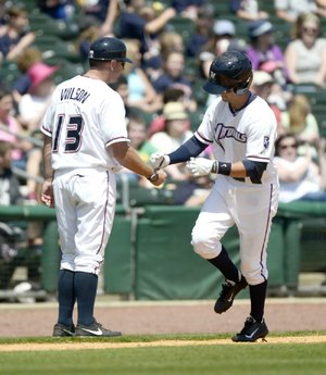 Northwest Arkansas Naturals shortstop Whit Merrifield (right) is congratulated by Manager Vance Wilson after hitting a two-run home run Wednesday against the Springfield Cardinals.