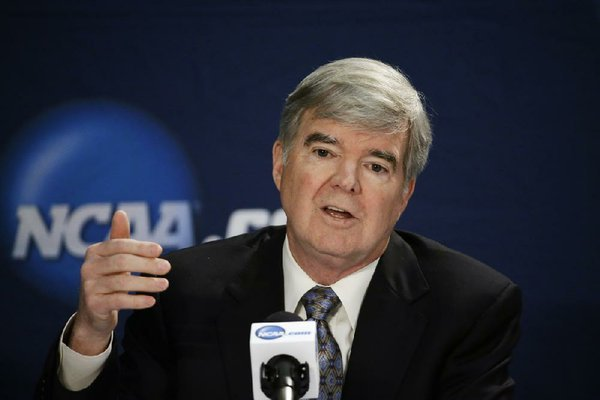 NCAA President Mark Emmert answers a question at a news conference Sunday, April 6, 2014, in Arlington, Texas. (AP Photo/David J. Phillip)