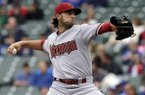 Arizona Diamondbacks starter Mike Bolsinger throws against the Chicago Cubs during the first inning of a baseball game in Chicago, Thursday, April 24, 2014. (AP Photo/Nam Y. Huh)