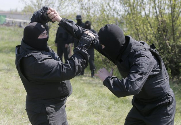 pro-ukrainian-self-defense-unit-perform-unarmed-combat-drill-at-their-training-ground-outside-donetsk-ukraine-on-thursday-april-24-2014-the-unit-consists-of-volunteer-residents-of-the-donetsk-region-to-combat-pro-russian-insurgents-in-the-donetsk-region