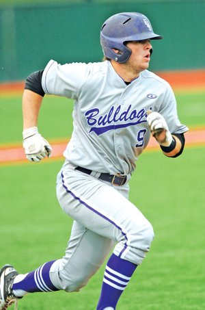 STAFF PHOTO ANDY SHUPE Drew Tyler of Fayetteville heads to first Thurday after hitting an RBI triple during the fourth inning of the Bulldogs' 1-0 win over Van Buren in Fayetteville.