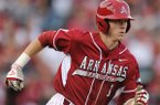 Arkansas second baseman Brian Anderson heads to first after hitting the ball to the outfield during the fourth inning against Auburn Friday, April 25, 2014, at Baum Stadium in Fayetteville.