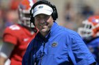 Florida coach Will Muschamp is all smiles after their spring NCAA college football scrimmage Saturday, April 12, 2014, in Gainesville, Fla. (AP Photo/Phil Sandlin)