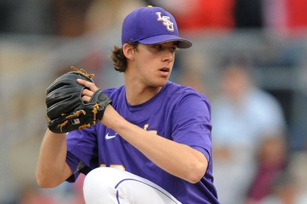 LSU's Aaron Nola pitches against Mississippi during an NCAA college baseball game in Oxford, Miss., on Thursday, April 17, 2014. (AP Photo/Oxford Eagle, Bruce Newman)
