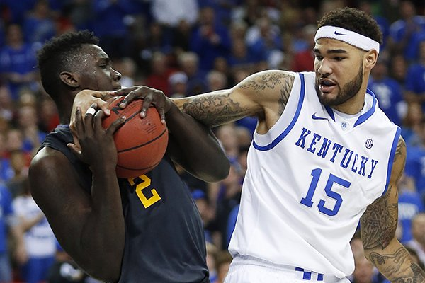 In this March 14, 2014, file photo, LSU forward Johnny O'Bryant III (2) holds onto the ball as Kentucky forward Willie Cauley-Stein (15) defends during the second half of an NCAA college basketball game in the quarterfinal round of the Southeastern Conference men's tournament in Atlanta. (AP Photo/John Bazemore, File)