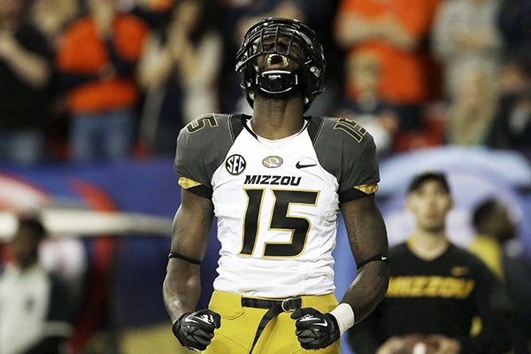 In this Dec. 7, 2013, file photo, Missouri wide receiver Dorial Green-Beckham celebrates his touchdown against Auburn during the first half of the Southeastern Conference NCAA college football championship game in Atlanta. Dorial Green-Beckham was suspended indefinitely Monday, April 7, 2014, for an unspecified violation of team rules, three months after he and two friends were arrested on suspicion of felony drug distribution when police found a pound of marijuana in their car. Coach Gary Pinkel announced the suspension without mentioning the January incident in which the standout receiver was arrested in his Missouri hometown of Springfield. (AP Photo/John Bazemore, File)