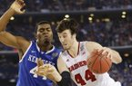 Wisconsin forward Frank Kaminsky (44) tries to get past Kentucky center Dakari Johnson (44) during the second half of the NCAA Final Four tournament college basketball semifinal game Saturday, April 5, 2014, in Arlington, Texas. (AP Photo/Eric Gay)
