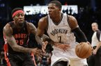 Brooklyn Nets' Joe Johnson (7) drives past Toronto Raptors' John Salmons (25) during the second half of Game 3 of an NBA basketball first-round playoff series Friday, April 25, 2014, in New York. The Nets won the game 102-98. (AP Photo/Frank Franklin II)