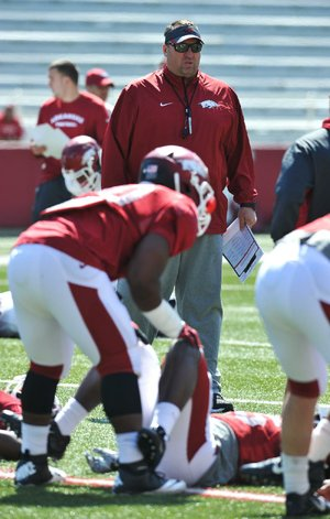 NWA Media/Michael Woods --04/05/2014-- w @NWAMICHAELW...University of Arkansas coach Bret Bielema watches his team warm up during practice Saturday morning at Razorback Stadium in Fayetteville.