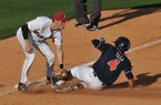 Arkansas third baseman Bobby Wernes puts the tag on Auburn base runner Ryan Tella as he tries to steal third base in the sixth inning of the first game of Saturday's doubleheader at Baum Stadum in Fayetteville.