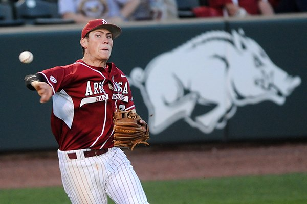 Arkansas third baseman Bobby Wernes throws to first base Tuesday, April 22, 2014, during the game against Northwest State at Baum Stadium in Fayetteville.