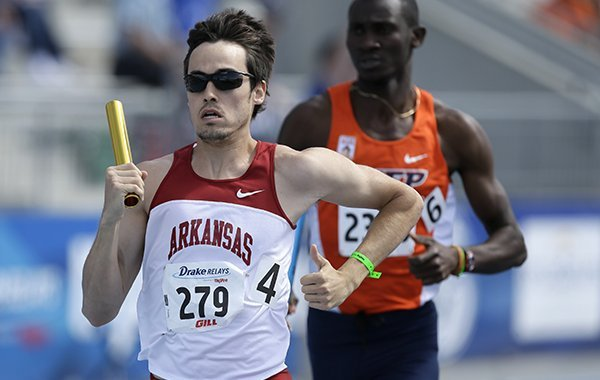 Arkansas' Neil Braddy leads UTEP's Abiola Onakoya during the university men's 1600-meter relay at the Drake Relays athletics meet on Friday, April 25, 2014, in Des Moines, Iowa. (AP Photo/Charlie Neibergall)