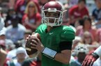 Arkansas quarterback Brandon Allen drops back to pass during the Red-White game Saturday, April 26, 2014 at Razorback Stadium in Fayetteville.