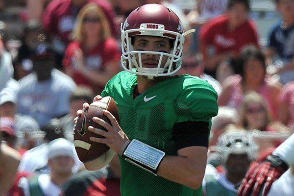 Arkansas quarterback Brandon Allen drops back to pass during the Red-White game Saturday afternoon at Razorback Stadium in Fayetteville.