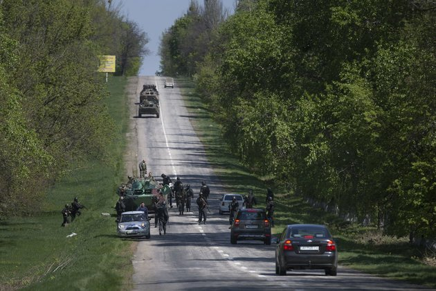 ukrainian-government-troops-around-their-armored-personal-carriers-stand-guard-on-a-country-road-outside-the-town-of-svyitohirsk-near-slovyansk-eastern-ukraine-saturday-ukrainian-authorities-are-undertaking-a-security-operation-to-liberate-the-nearby-city-of-slovyansk-which-is-currently-controlled-by-an-armed-pro-russian-insurgency