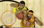 Michigan's Jon Horford and Tennessee's Jarnell Stokes (5) go after a rebound during the second half of an NCAA Midwest Regional semifinal college basketball tournament game Friday, March 28, 2014, in Indianapolis. (AP Photo/Michael Conroy)