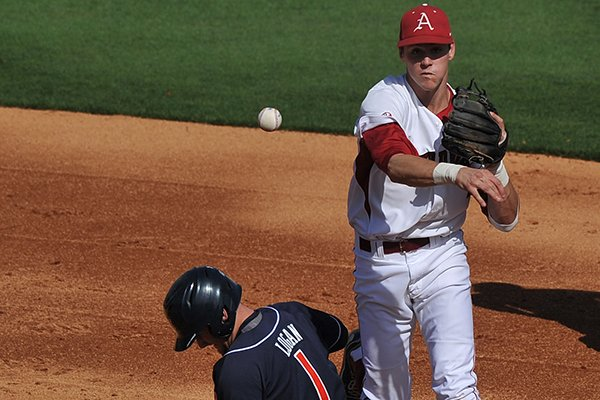 Arkansas second baseman Brian Anderson forces out Auburn baserunner Blake Logan out at second base in the second inning of the first game of Saturday's doubleheader at Baum Stadium in Fayetteville.