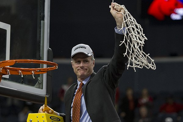 Central Missouri head basketball coach Kim Anderson acknowledges his team's fan base after cutting down the net after winning the the NCAA college Division II men's basketball championship against West Liberty in Evansville, Ind., Saturday, March 29, 2014. (AP Photo/Courier & Press, Denny Simmons)