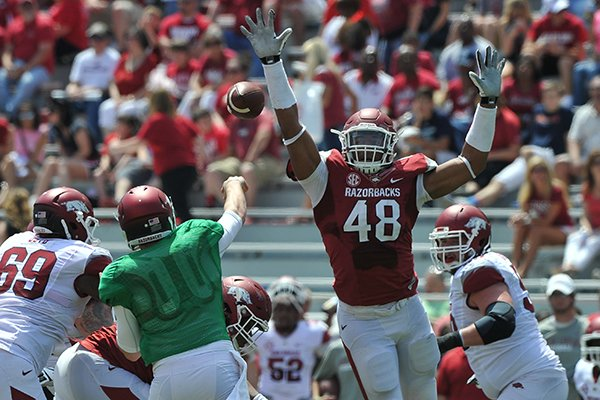 Arkansas defender Deatrich Wise Jr. puts the pressure on quarterback Austin Allen during the Red-White game Saturday afternoon at Razorback Stadium in Fayetteville.