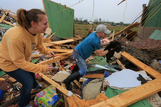 arkansas-democrat-gazetterick-mcfarland-042814-teela-baxter-is-eager-to-be-reunited-with-her-cat-pete-after-her-husband-matt-rescued-him-unharmed-from-underneath-debris-of-their-home-monday-on-aspen-creek-dr-in-vilonia-after-it-was-destroyed-by-the-tornado-that-hit-the-area-sunday-night-the-baxters-were-not-home-at-the-time-the-tornado-hit